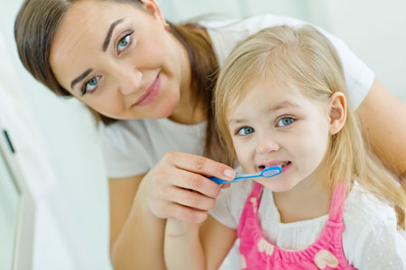 Mom and Daughter brushing their teeth - Pediatric Dentist in Alpharetta and Suwanee, GA
